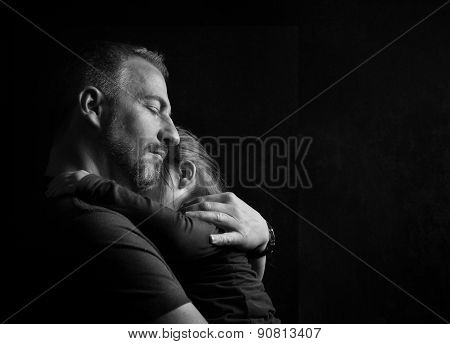 Father Hugging Daughter Tenderly