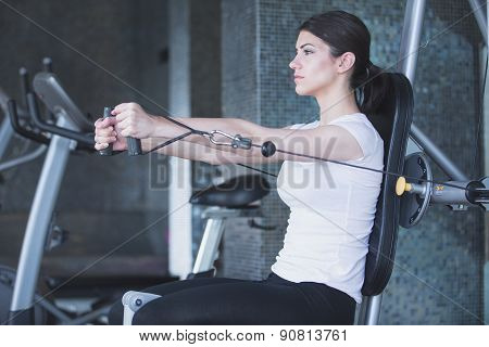 Fitness,sport lifestyle concept.Dedicated woman doing exercises with expander in gym.Fitness girl