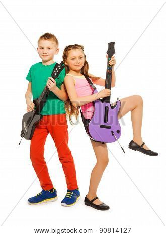 Boy and girl rock together playing on guitars