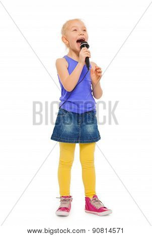Girl singing karaoke in microphone and standing