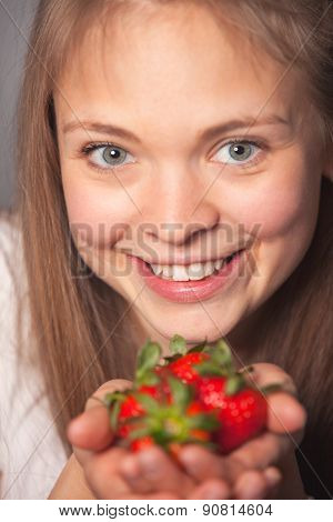 Pretty Girl Holding Strawberries With Toothy Smile