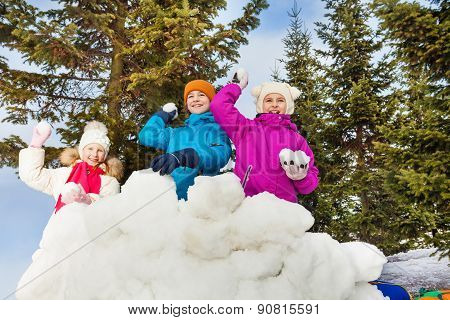 Group of kids play snowballs game together