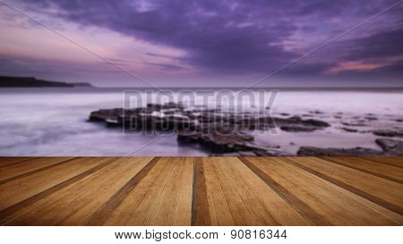 Beautiful Toned Seascape Landscape Of Rocky Shore At Sunset With Wooden Planks Floor