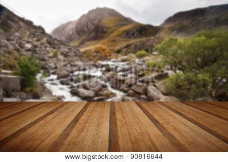 View Of Tryfan Looking Up Ogwen Falls In Autumn Fall With Wooden Planks Floor