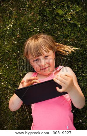 Little Girl With The Tablet.