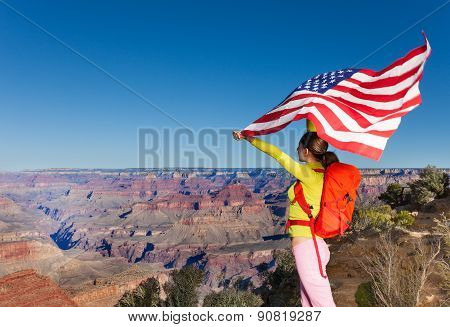 Woman holding US flag, Grand Canyon National Park