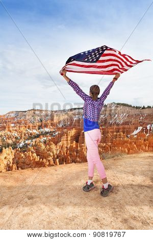 Woman holds US flag, Bryce Canyon National Park