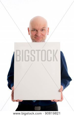 Man With Bald Head In Is Pointing To A Canvas