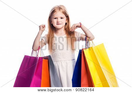 Young Girl Child Holding Colourful Shopping Bags.