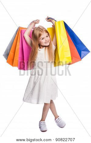 Happy Excited Young Female Shopper Holding Big Bags.