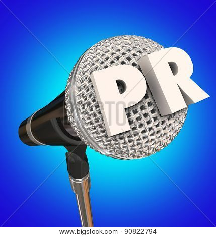 PR letters for Public Relations word on a mike, mic, or microphone on a stand to illustrate an interview or report to get your message to an audience