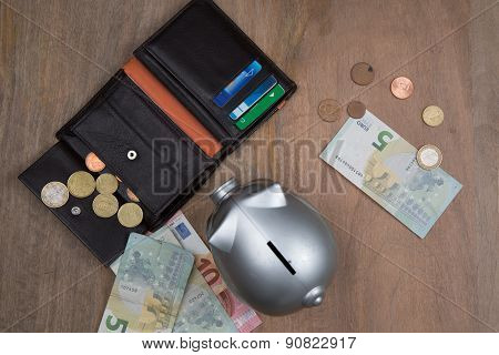Buisness, Banking And Savings Concept -   Money Into Small Grey Piggy Bank