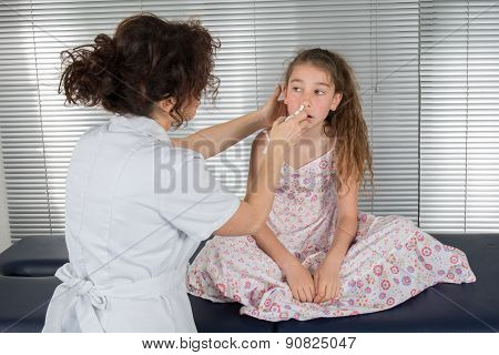 Auscultation, Young Girl Doctor Tries To Clean Her Noise