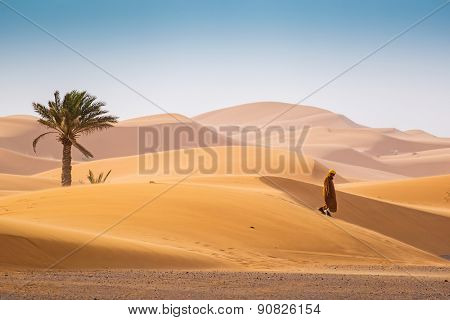 MERZOUGA, MOROCCO, APRIL 13, 2015: Local man walks on Dunes Erg Chebbi near Merzouga
