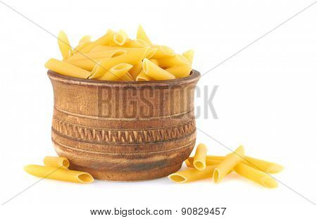 Penne italian pasta in wood bowl, isolated on white background
