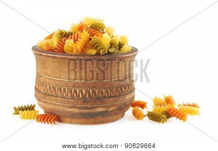 Fusilli italian pasta in wood bowl, isolated on white background
