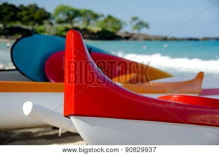 Colorful Outriggers, Canoes And Boards At Kaunaoa Beach