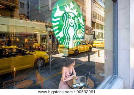 Woman in Starbucks cafe