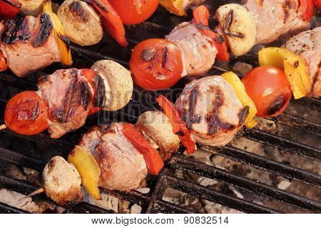Pork And Vegetables Skewers Cooking On Bbq Grill