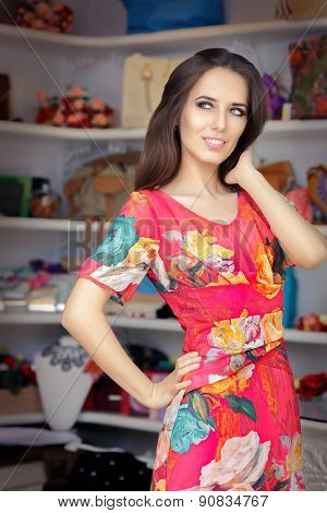 Woman in Red Floral Dress in Fashion Store