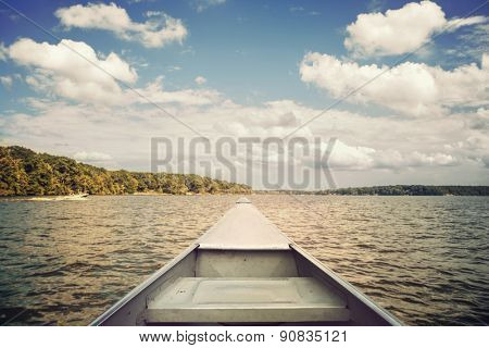 Bow of a canoe on a lake. Focus on bow.  Vintage effect.
