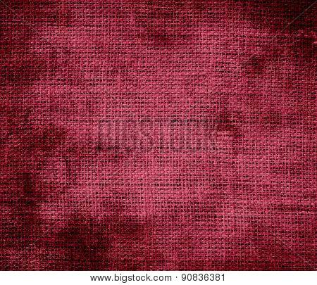 Grunge background of big dip o ruby burlap texture