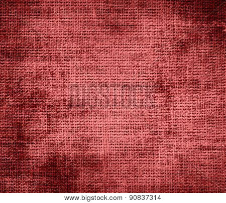 Grunge background of bittersweet shimmer burlap texture