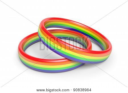Two wedding rings with rainbow flag colors, a symbol of gay or same sex partnerships