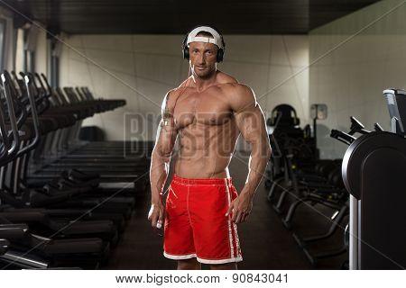 Portrait Of A Man In Gym Listening Music