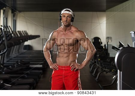Aesthetic Man Listening Music In Modern Fitness Center