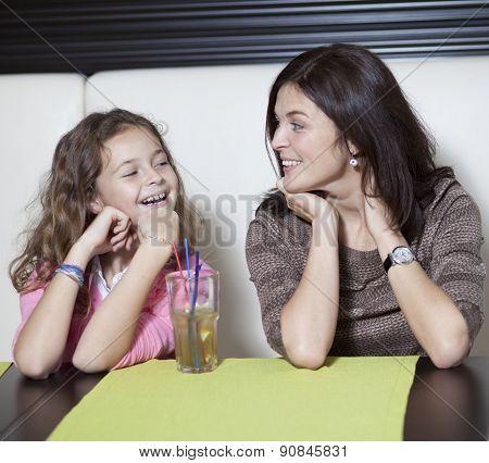 Happy family drinking orange juice