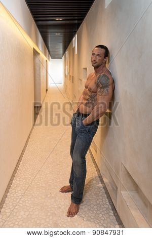 Handsome Man Poses In Modern Corridor