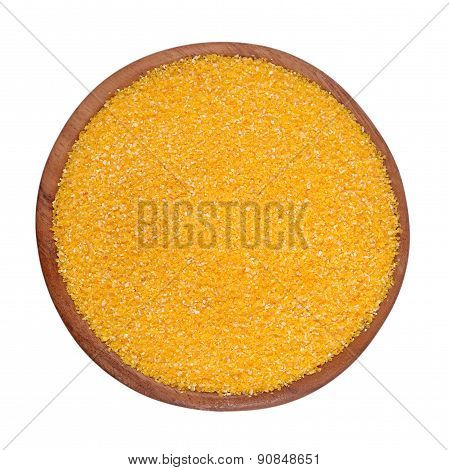 Corn Grits In A Wooden Bowl On A White Background