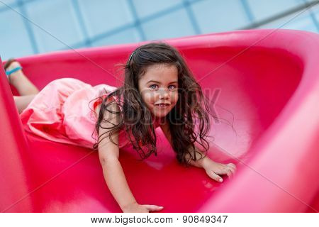 Girl On Red Slide