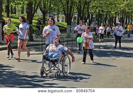 Marathon Runners On The Street Stefan Cel Mare With The Participation Of Persons With Disabilities