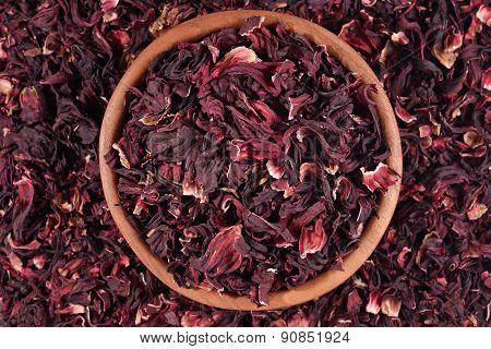 Dried Petals Of Hibiscus In A Wooden Bowl