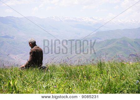 Praying Man Kneeling Rear View