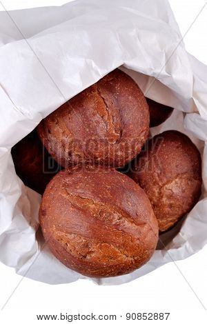 Fresh And Delicious Bread In A Paper Bag On A White Background