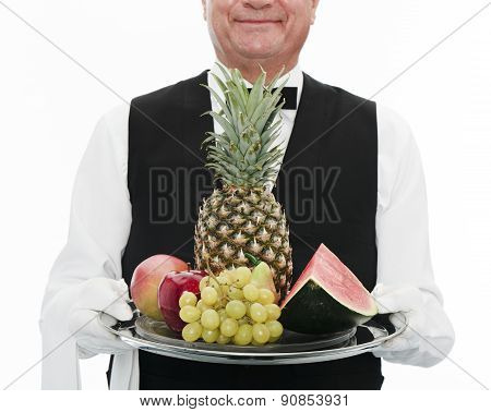 Waiter holding tray with fruits