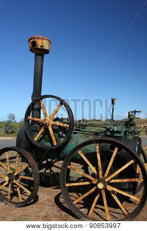 Historic black and green rusty Steam Engine Tractor