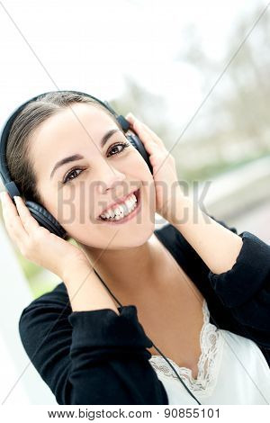Smiling Happy Woman Listening To Music