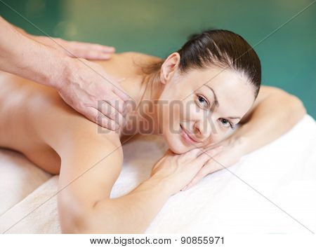 health, beauty, resort and relaxation concept - beautiful woman in spa salon getting massage