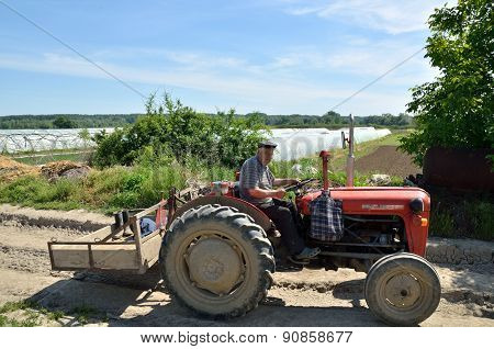 Old Man On A Tractor