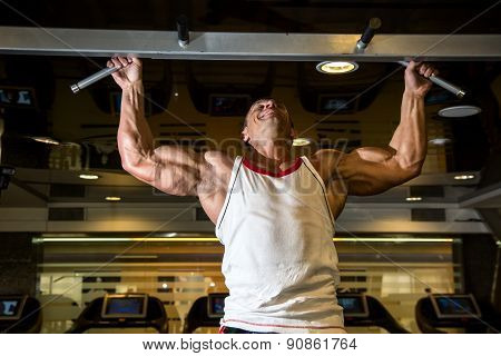 Muscle Athlete Man In Gym Making Elevations.