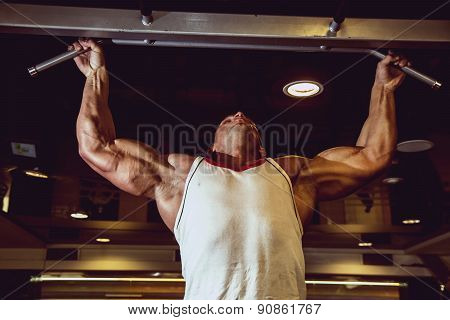 Handsome Muscular Man In Gym Making Elevations.