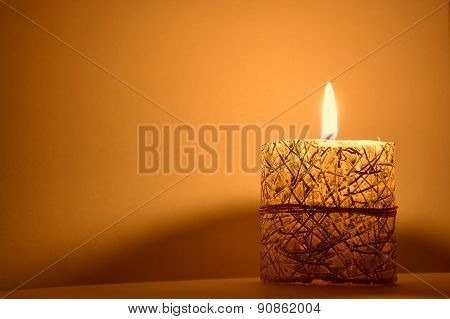 Candle burns on the table