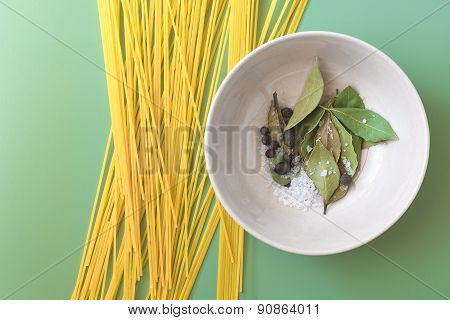 Uncooked pasta and spices in a bowl