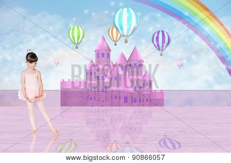 Little balerina in front of a pink fairy castle