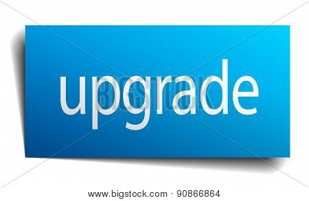 Upgrade Blue Paper Sign Isolated On White