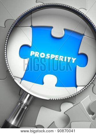 Prosperity - Missing Puzzle Piece through Magnifier.